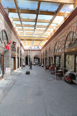 kapalicarsi: BURSA, TURKEY - JULY 23, 2016: Shops in old Kapalicarsi of Bursa. Kapalicarsi complex was started to be built from 15th century.