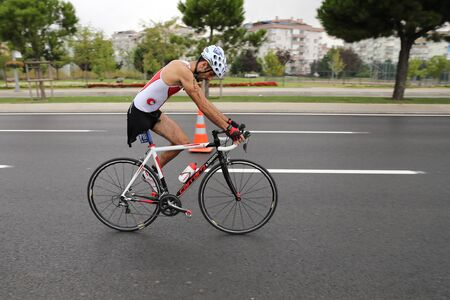 ISTANBUL, TURKEY - AUGUST 21, 2016: Athletes competing in cycling component of Istanbul Triathlon in Marmara Sea coast. 586 triathletes attempt to sixth Istanbul Thriathlon.