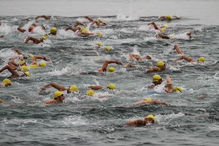 ISTANBUL, TURKEY - AUGUST 21, 2016: Athletes competing in swimming component of Istanbul Triathlon in Marmara Sea coast. 586 triathletes attempt to sixth Istanbul Thriathlon. Editorial