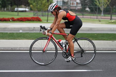 attempt: ISTANBUL, TURKEY - AUGUST 21, 2016: Athletes competing in cycling component of Istanbul Triathlon in Marmara Sea coast. 586 triathletes attempt to sixth Istanbul Thriathlon.