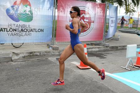 ISTANBUL, TURKEY - AUGUST 21, 2016: Athletes competing in running component of Istanbul Triathlon in Marmara Sea coast. 586 triathletes attempt to sixth Istanbul Thriathlon. Editorial