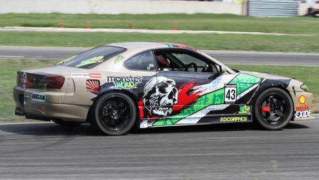 IZMIT, TURKEY - AUGUST 28, 2016: Cafer Aracilar drives a drift car in Apex Masters Turkish Drift Series Izmit Race.