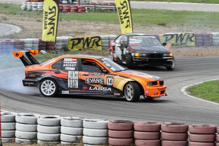 IZMIT, TURKEY - AUGUST 28, 2016: Volkan Arisoy drives BMW E36 325 of Parkur Racing Team in Apex Masters Turkish Drift Series Izmit Race. Editorial