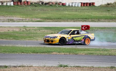 IZMIT, TURKEY - AUGUST 28, 2016: Oktay Kabaktas drives Nissan 200SX S14A of Teamart Dream Drift Team in Apex Masters Turkish Drift Series Izmit Race. Editorial