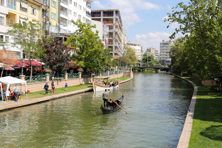 touristy: ESKISEHIR, TURKEY - SEPTEMBER 03, 2016: Gondola tours in Porsuk river. Porsuk river is one of the most populer touristy place with boat tours and entertainment in Eskisehir. Editorial