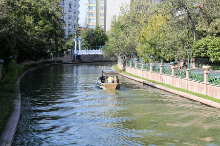 touristy: ESKISEHIR, TURKEY - SEPTEMBER 04, 2016: People in Gondola tour in Porsuk river. Porsuk river is one of the most populer touristy place with boat tours and entertainment in Eskisehir. Editorial