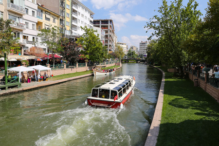 touristy: ESKISEHIR, TURKEY - SEPTEMBER 03, 2016: Boat tour in Porsuk river. Porsuk river is one of the most populer touristy place with boat tours and entertainment in Eskisehir.