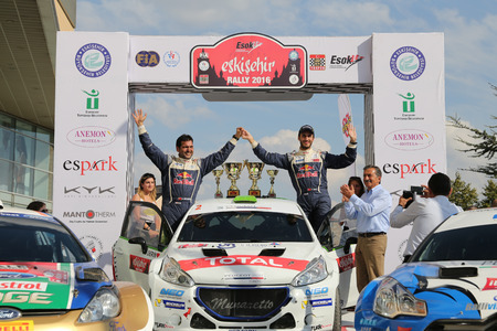 ESKISEHIR, TURKEY - SEPTEMBER 04, 2016: Yagiz Avci with Peugeot 208 T16 R5 of Neomotorspor Team in finish ceremony of Eskisehir Rally
