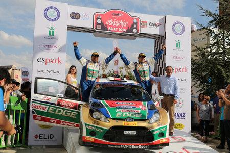turkiye: ESKISEHIR, TURKEY - SEPTEMBER 04, 2016: Orhan Avcioglu with Ford Fiesta S2000 of Castrol Ford Team Turkiye in finish ceremony of Eskisehir Rally