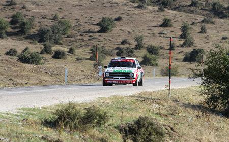 escort: ESKISEHIR, TURKEY - SEPTEMBER 03, 2016: Engin Kap drives Ford Escort MK2 of Bonus Unifree Parkur Racing Team in Eskisehir Rally