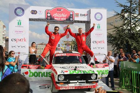 ESKISEHIR, TURKEY - SEPTEMBER 04, 2016: Burak Turkkan with Ford Escort MK2 of Parkur Historic Team in finish ceremony of Eskisehir Rally