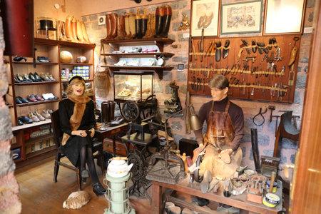 cobbler: ISTANBUL, TURKEY - JULY 29, 2016: Old cobbler shop recreation in Rahmi M. Koc Industrial Museum. Koc museum is industrial Museum dedicated to history of transport, industry and communications