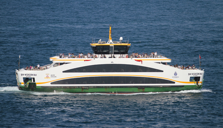ISTANBUL, TURKEY - JULY 30, 2016: Sehir Hatlari ferry carry passengers between Asian and European sides of Istanbul. Sehir Hatlari was established in 1844 and now carry 150,000 passengers a day. Editorial
