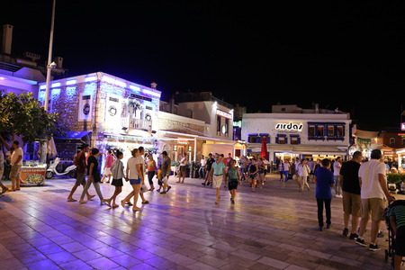 mugla: MUGLA, TURKEY - SEPTEMBER 11, 2016: People in Bodrum bar street at night. Bodrum bar street is one of the most famous nightlife district in Turkey.