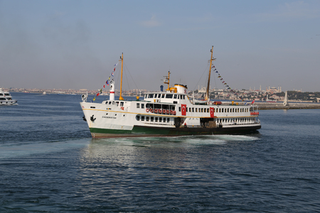 seaway: ISTANBUL, TURKEY - SEPTEMBER 15, 2016: Sehir Hatlari ferry carry passengers between Asian and European sides of Istanbul. Sehir Hatlari was established in 1844 and now carry 150,000 passengers a day.
