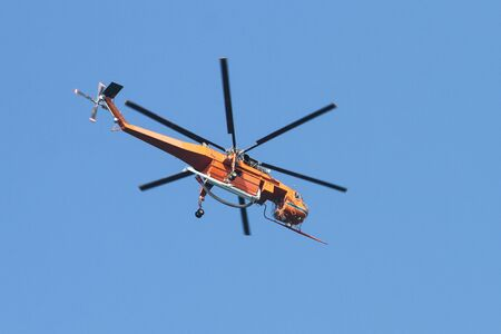 Orange Fire Helicopter is flying over Istanbul city Stock Photo