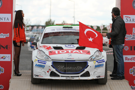 ISTANBUL, TURKEY - SEPTEMBER 24, 2016: Yagiz Avci with Peugeot 208 T16 R5 of Neomotorspor Team in ceremonial start of Istanbul Rally Editöryel