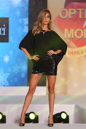 ISTANBUL, TURKEY - DECEMBER 12, 2016: Model Cagla Sikel showcases creations in stores in Optimum Mall during Optimum Mall Fashion Show