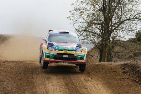 corum: CORUM, TURKEY - OCTOBER 29, 2016: Orhan Avcioglu drives Ford Fiesta S2000 of Castrol Ford Team Turkiye in Corum Hitit Rally Editorial