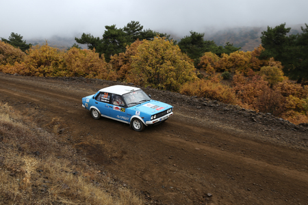 corum: CORUM, TURKEY - OCTOBER 29, 2016: Ali Nijad Sirel drives Fiat 131 in Corum Hitit Rally