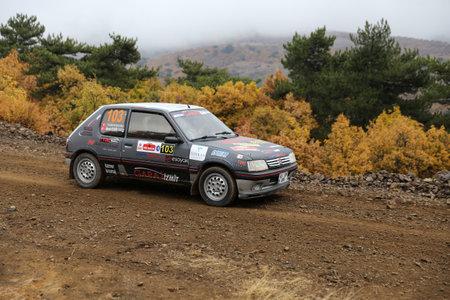 corum: CORUM, TURKEY - OCTOBER 29, 2016: Ahmet Keskin drives Peugeot 205 GTI in Corum Hitit Rally