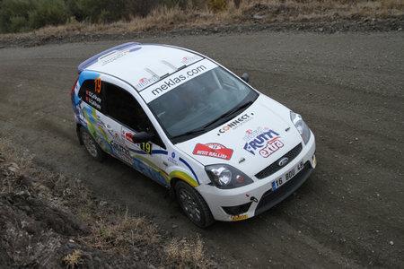 corum: CORUM, TURKEY - OCTOBER 29, 2016: Onur Celikyay drives Ford Fiesta ST in Corum Hitit Rally Editorial