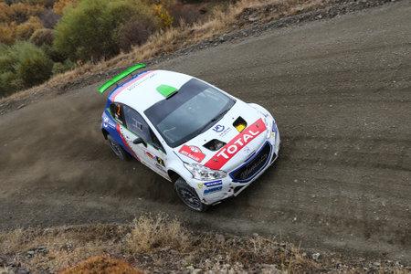 corum: CORUM, TURKEY - OCTOBER 29, 2016: Yagiz Avci drives Peugeot 208 T16 R5 of Neomotorspor Team in Corum Hitit Rally