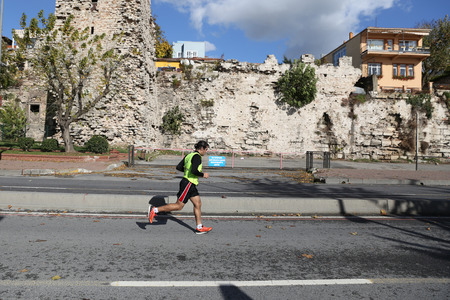 ISTANBUL, TURKEY - NOVEMBER 13, 2016: Athlete running in 38. Istanbul marathon which includes two continents in one race. Marathon starts on the Asian side and finishs in European side of Istanbul.