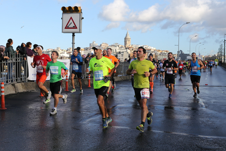 ISTANBUL, TURKEY - NOVEMBER 13, 2016: Athletes running in 38. Istanbul marathon which includes two continents in one race. Marathon starts on the Asian side and finishs in European side of Istanbul. Editorial