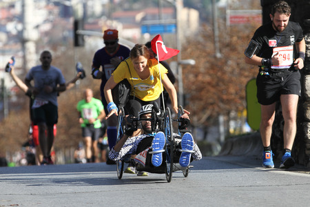 ISTANBUL, TURKEY - NOVEMBER 13, 2016: Paralympic athlete run in 38. Istanbul marathon which includes two continents in one race. Marathon starts on the Asian side and finishs in European Istanbul.