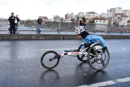 paralympic: ISTANBUL, TURKEY - NOVEMBER 13, 2016: Paralympic athlete run in 38. Istanbul marathon which includes two continents in one race. Marathon starts on the Asian side and finishs in European Istanbul.