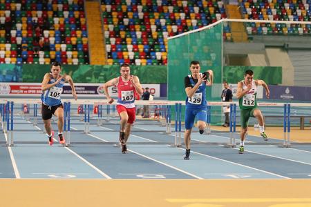ISTANBUL, TURKEY - FEBRUARY 12, 2017: Athletes running 60 metres hurdles during Balkan Junior Indoor Championships