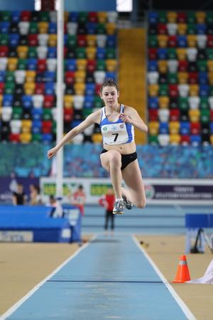 anja: ISTANBUL, TURKEY - FEBRUARY 12, 2017: Athlete Anja Colakovic triple jumping during Balkan Junior Indoor Championships