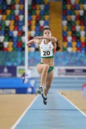 ISTANBUL, TURKEY - FEBRUARY 12, 2017: Athlete Aleksandra Nacheva triple jumping during Balkan Junior Indoor Championships