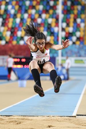 ISTANBUL, TURKEY - FEBRUARY 12, 2017: Athlete Esra Yilmaz triple jumping during Balkan Junior Indoor Championships Editorial