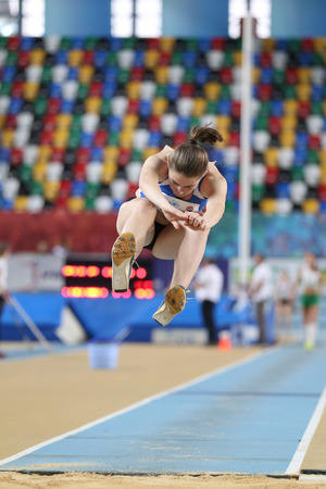 ISTANBUL, TURKEY - FEBRUARY 12, 2017: Athlete Anja Colakovic triple jumping during Balkan Junior Indoor Championships