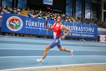 metres: ISTANBUL, TURKEY - FEBRUARY 12, 2017: Athlete David Salamon running 4x400 metres during Balkan Junior Indoor Championships
