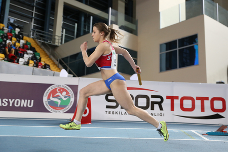 anja: ISTANBUL, TURKEY - FEBRUARY 12, 2017: Athlete Anja Kovac running 4x400 metres during Balkan Junior Indoor Championships Editorial