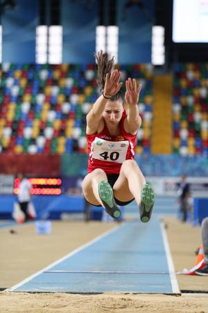 ISTANBUL, TURKEY - FEBRUARY 12, 2017: Athlete Martina Miroska long jumping during Balkan Junior Indoor Championships