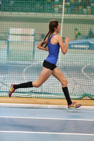 december 25: ISTANBUL, TURKEY - DECEMBER 25, 2016: Athlete Emine Hatun Tuna running during Turkish Athletic Federation Indoor Athletics Record Attempt Races