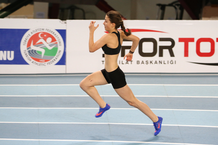 december 25: ISTANBUL, TURKEY - DECEMBER 25, 2016: Athlete Ilke Celebi running during Turkish Athletic Federation Indoor Athletics Record Attempt Races