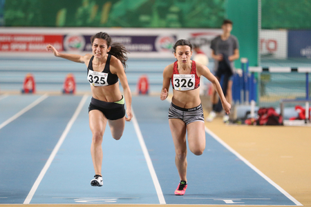 ISTANBUL, TURKEY - DECEMBER 24, 2016: Athletes running 60 meters during Turkish Athletic Federation Indoor Athletics Record Attempt Races Editorial