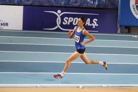 ISTANBUL, TURKEY - DECEMBER 24, 2016: Athlete Emine Hatun Tuna running during Turkish Athletic Federation Indoor Athletics Record Attempt Races Editorial