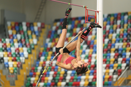vaulting: ISTANBUL, TURKEY - DECEMBER 24, 2016: Athlete Buse Arikazan pole vaulting during Turkish Athletic Federation Indoor Athletics Record Attempt Races