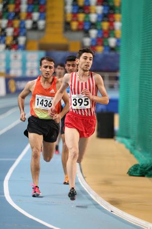 december 25: ISTANBUL, TURKEY - DECEMBER 25, 2016: Athletes running during Turkish Athletic Federation Indoor Athletics Record Attempt Races