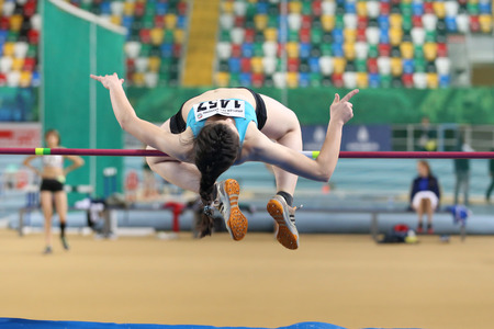 ISTANBUL, TURKEY - DECEMBER 25, 2016: An Athlete High Jumping during Turkish Athletic Federation Indoor Athletics Record Attempt Races Editorial