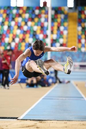 december 25: ISTANBUL, TURKEY - DECEMBER 25, 2016: Athlete Oguz Kagan Hacioglu Triple Jumping during Turkish Athletic Federation Indoor Athletics Record Attempt Races