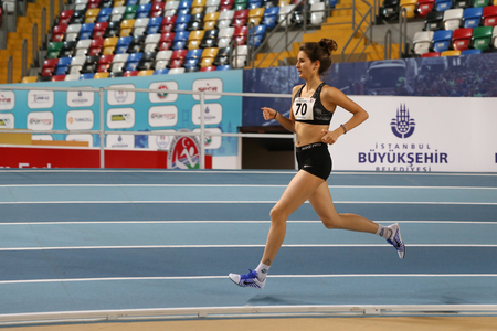 ISTANBUL, TURKEY - DECEMBER 18, 2016: Athlete Meltem Yasar running during Turkish Athletic Federation Olympic Threshold Indoor Competitions