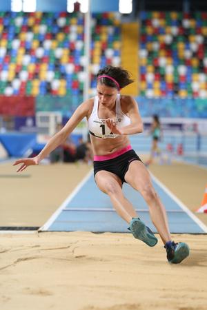 ISTANBUL, TURKEY - DECEMBER 18, 2016: Athlete Ezgi Arindi Long Jumping during Turkish Athletic Federation Olympic Threshold Indoor Competitions