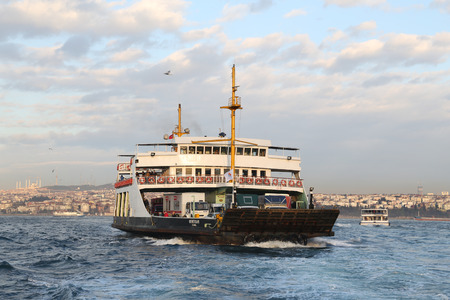 seaway: ISTANBUL, TURKEY - MARCH 20, 2017: Istanbul Deniz Otobusleri ferry passing from Asian to European side of Istanbul. 18 ferries in 3 different types carry passengers and vehicles between Sirkeci and Harem. Editorial